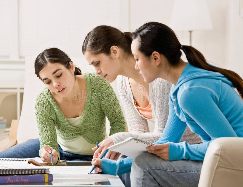 Students helping each other do their homework royalty free stock images