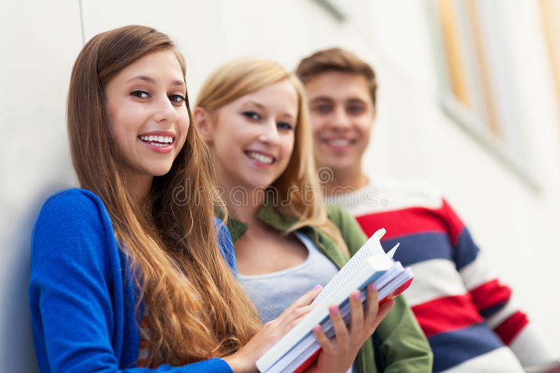 Students Holding Their Books Stock Image