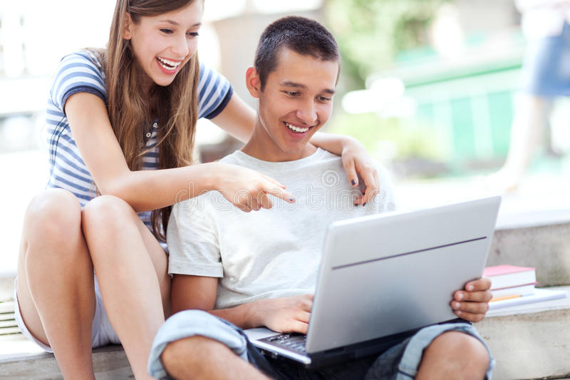 Download Students with laptop stock image. Image of friends, teenager - 26478569