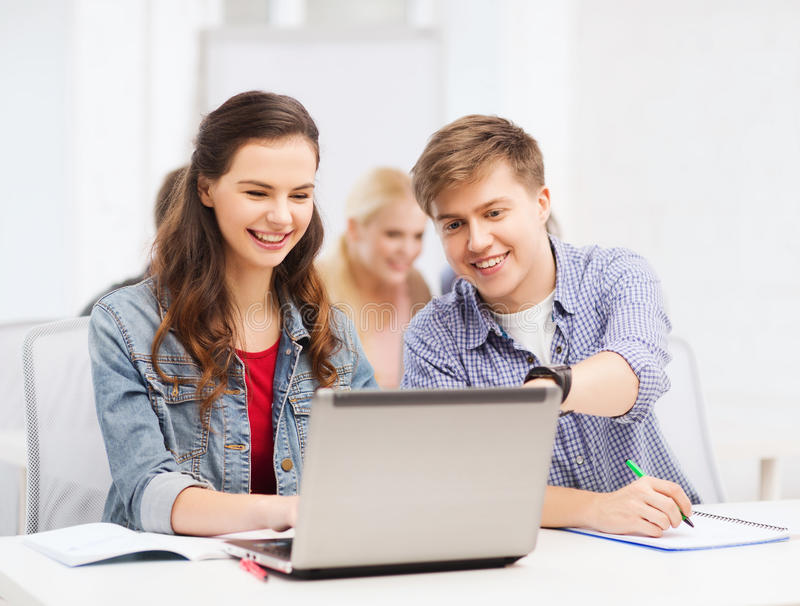 Students With Laptop And Notebooks At School Stock Photos