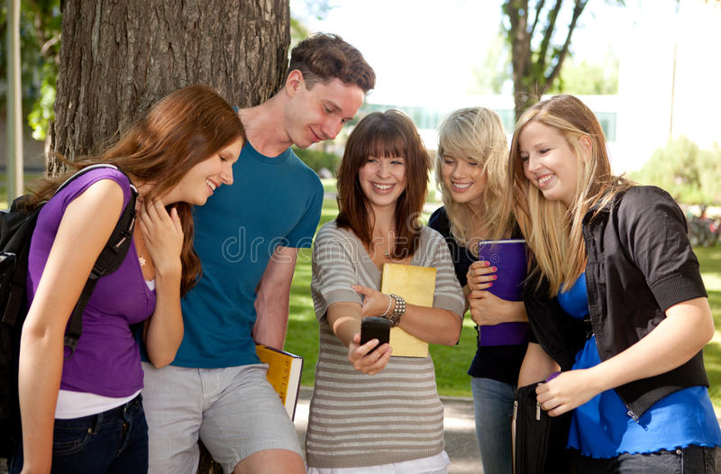 Students Laughing at Phone royalty free stock photos