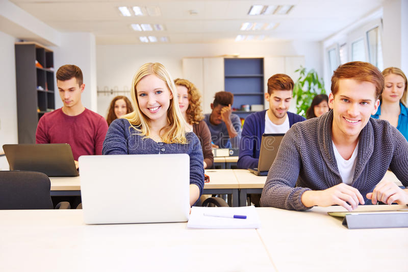 Students learning with computers. In a university class stock image