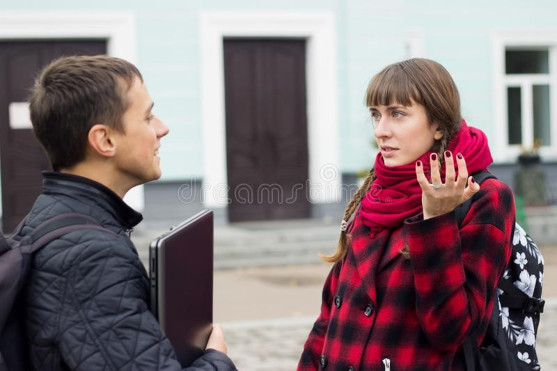 Students learning concept - boy and girl talking about examination passed royalty free stock photo