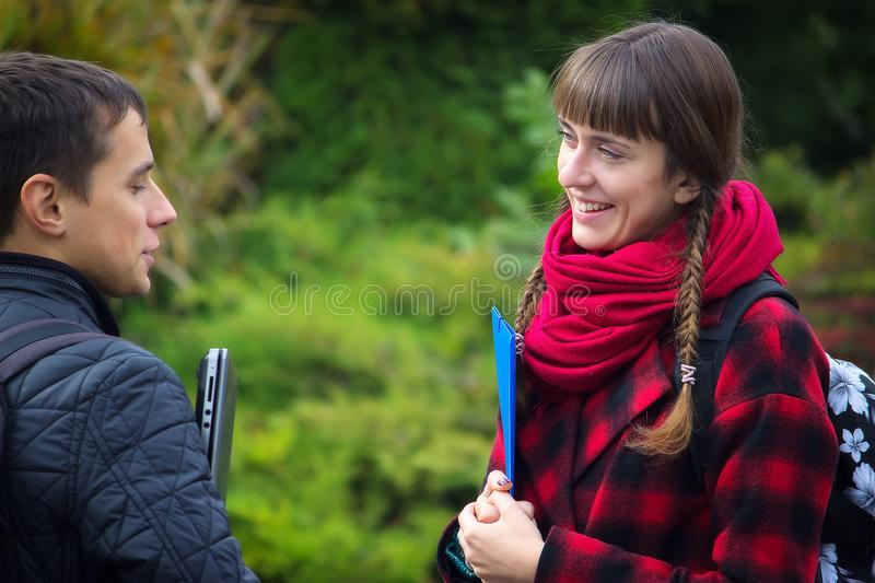 Students learning concept - boy and girl talking about examination passed stock photos