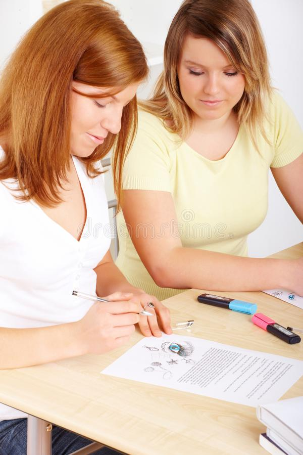 Students learning at desk stock photography