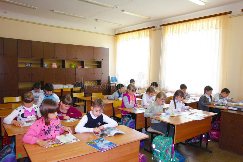 Students in the lesson in class stock images