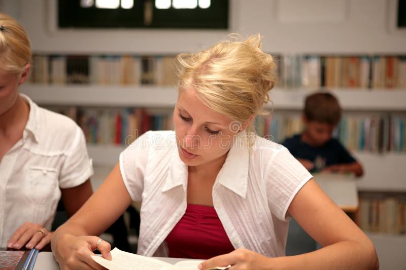 Download Students in library stock photo. Image of objects, clothing - 10834306