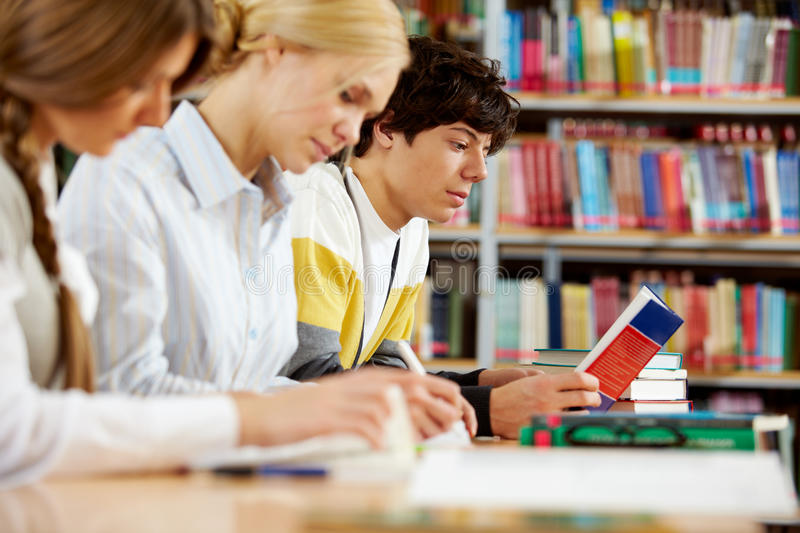 Students in library stock images