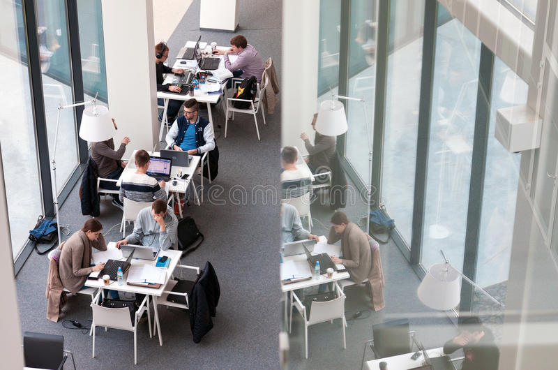 Students at the library. Vilnius, Lithuania - April 23, 2016: Students sitting and studying at Vilnius University library, Lithuania royalty free stock photography