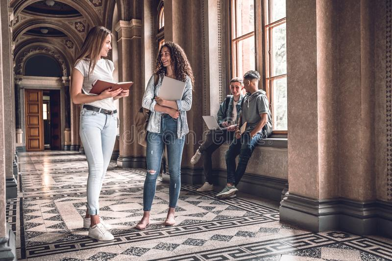 Students life!Group of beautiful students standing together and royalty free stock images