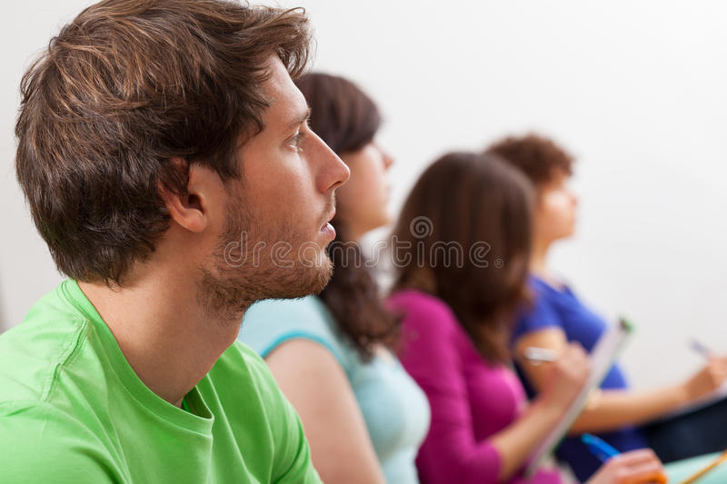 Students listening lecture royalty free stock photos
