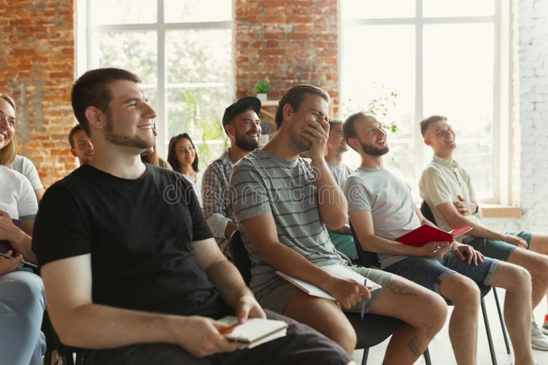Students listening to presentation in hall at university workshop royalty free stock image