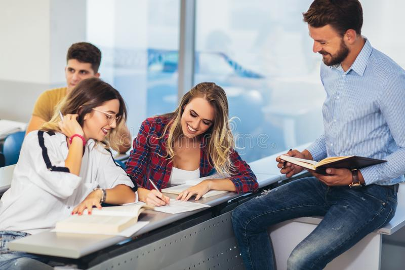 Students listening to professor in the classroom on college stock image