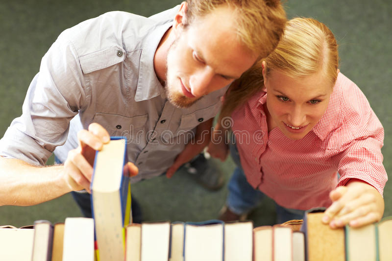 Download Students looking for books stock image. Image of encyclopedia - 11850927