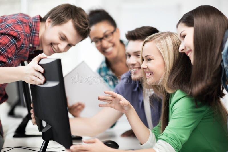 Students looking at computer monitor at school. Education concept - students looking at computer monitor at school royalty free stock images
