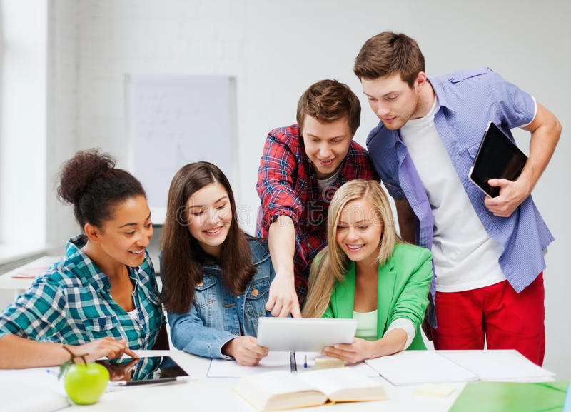 Students Looking At Tablet Pc At School Royalty Free Stock Images