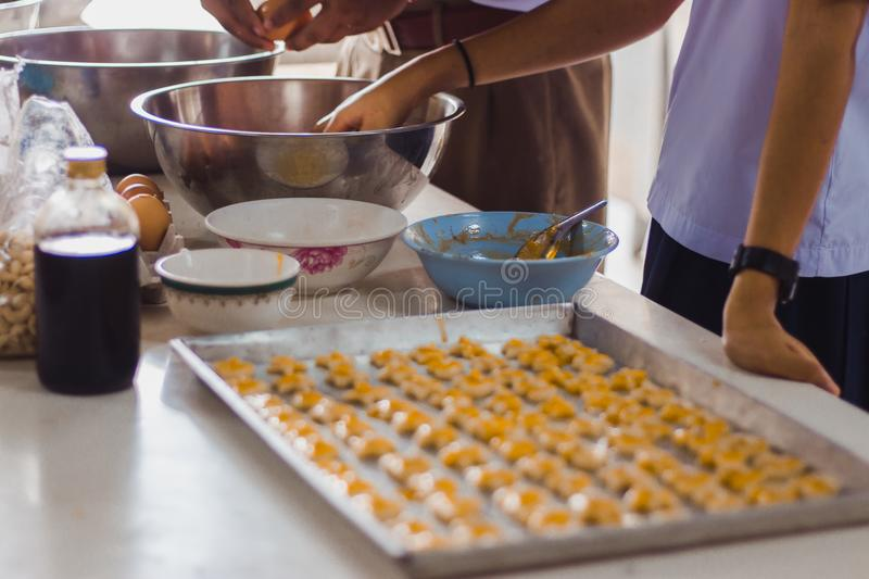 Students making Singapore cookies from dough in school. Students making Singapore cookies from dough in school in Thailand stock photos