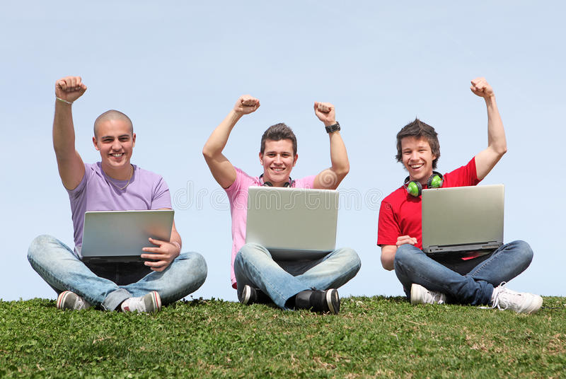 Students outdoors with laptops royalty free stock images