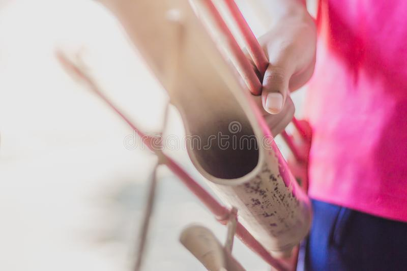 Students perform agkalug for the final exam. `Agkalug` Thailand is one of the instruments made of wood with a shaking voice royalty free stock photography