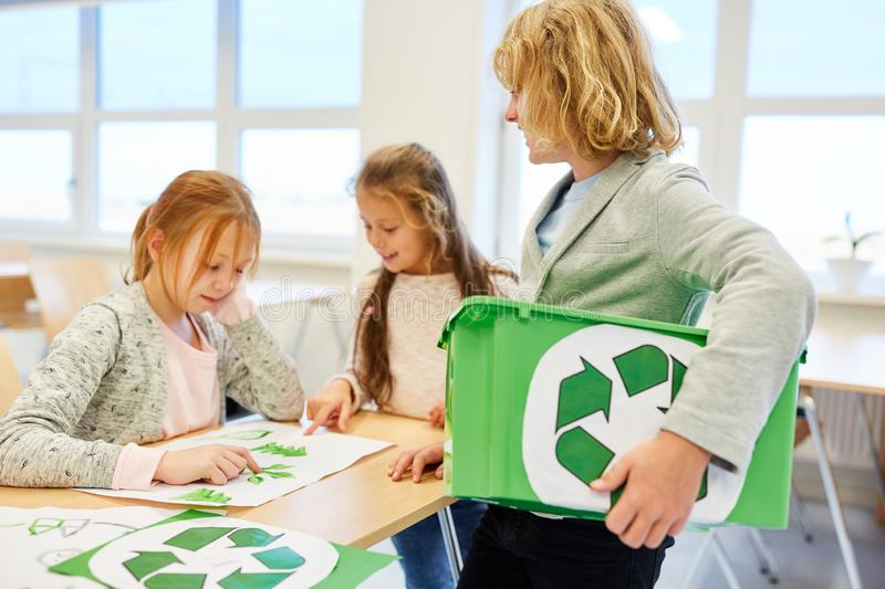Students are planning a recycling project. Students plan a recycling project in elementary school as a team royalty free stock photography