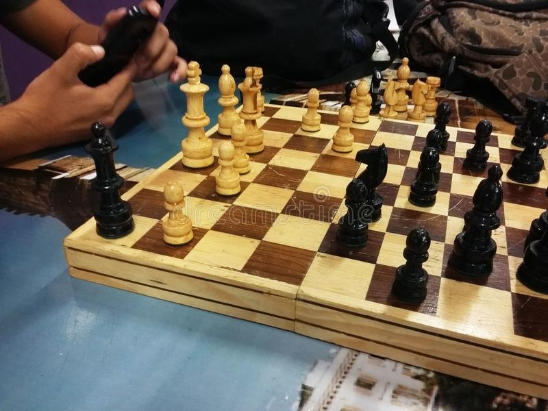 Students playing chess stock photography