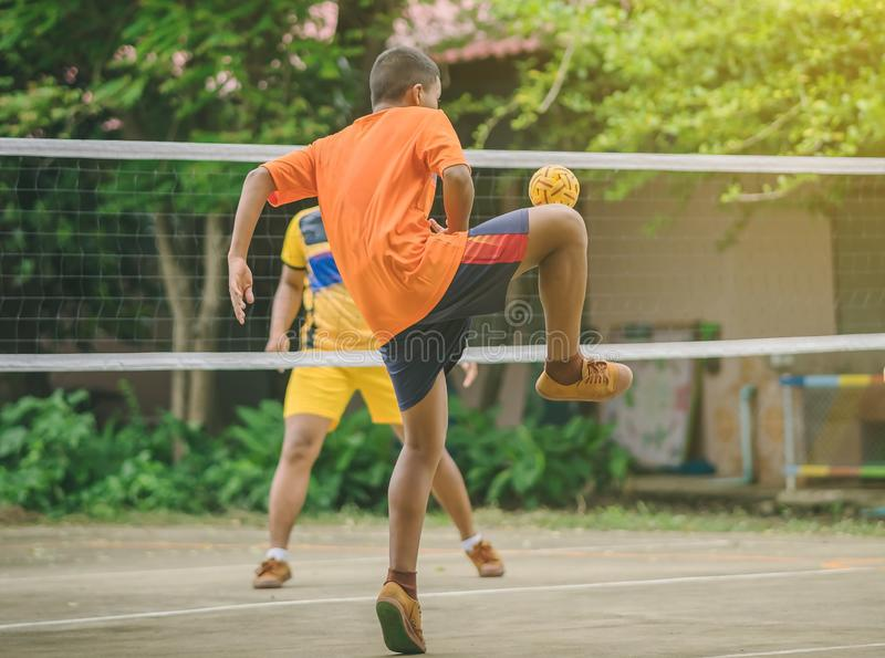 Students playing traditional asian sport game sepak takraw stock photography
