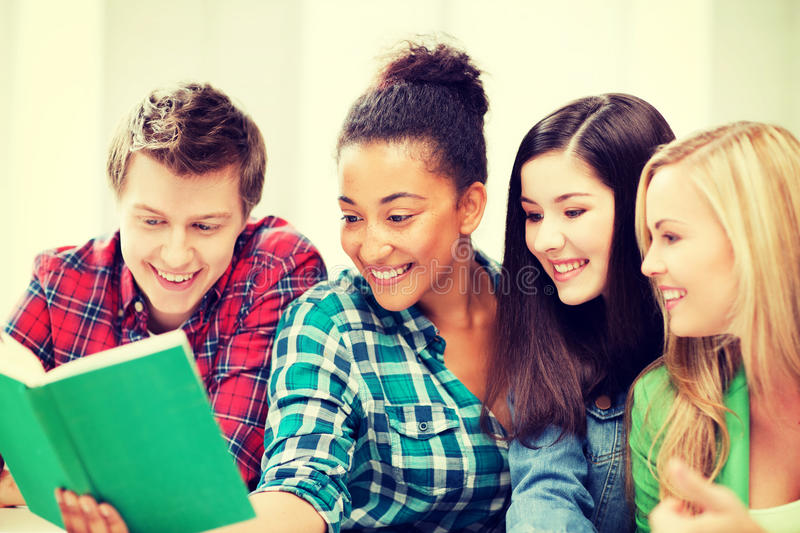 Students reading book at school royalty free stock photos