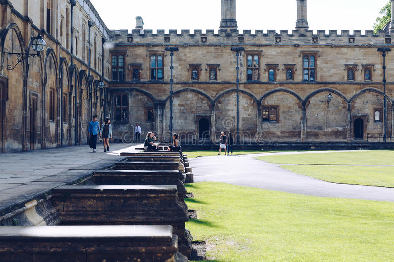 Students relax in the The Great Quadrangle of Christ Church College royalty free stock photography