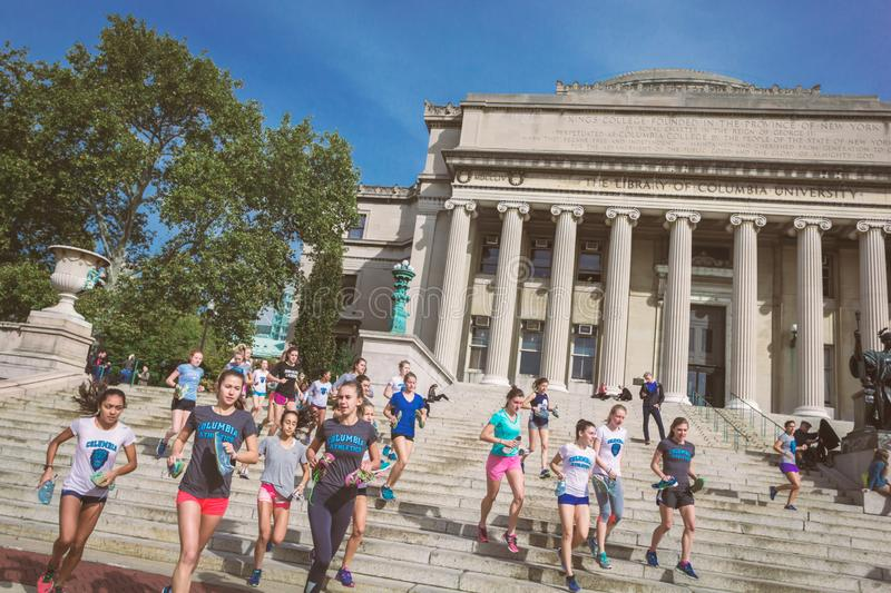 Students running on Columbia University Library building stairs stock photography