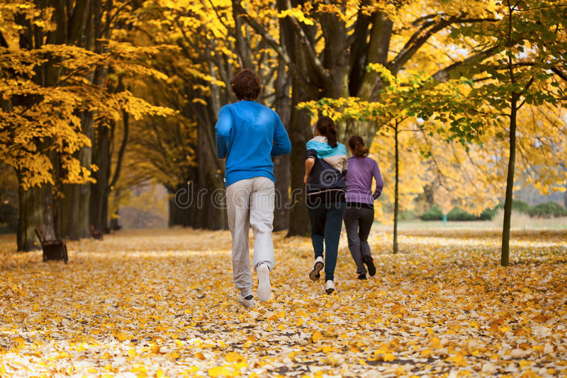 Students running in park stock photos
