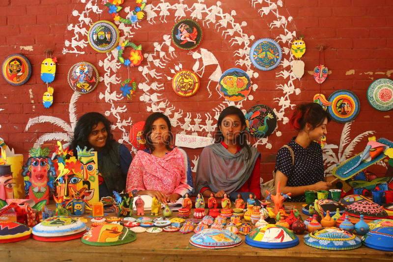 Students are selling bengali new year festival motif, mask, mascots and beautiful crafts. royalty free stock images