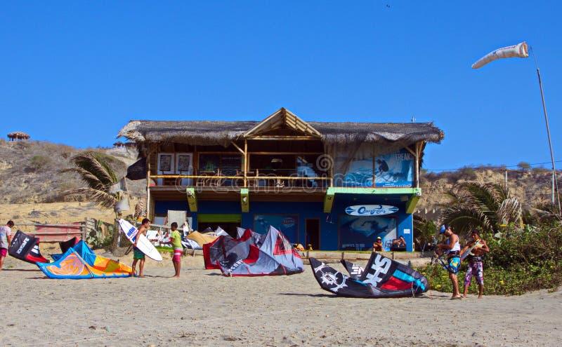 Kite Surfing School, Santa Marianita Beach Ecuador. Students setting up kite equipment outside Ocean Freaks kite surfer school on a windy day in Santa Marianita