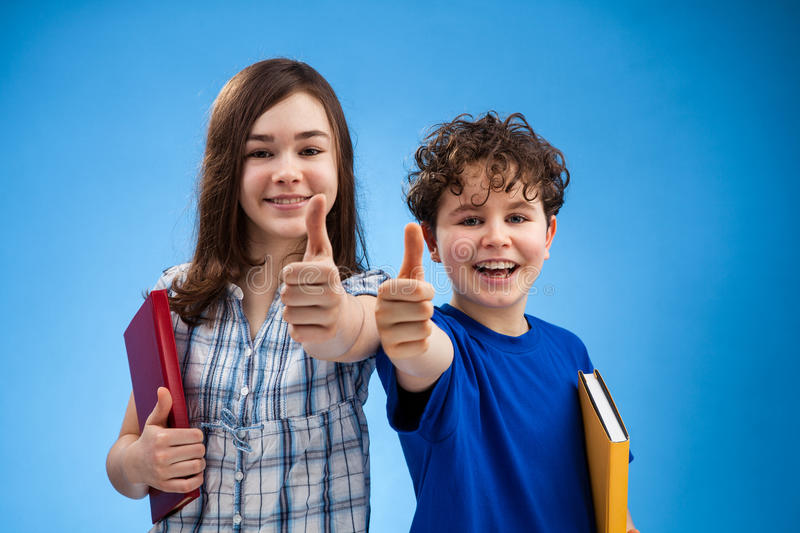 Students showing Ok sign. Students showing thumb up sign stock images