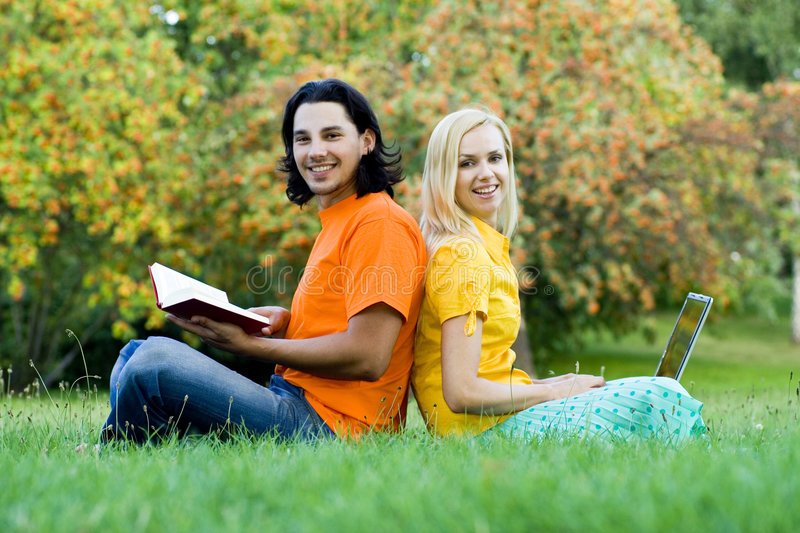 Students Sitting Back To Back Stock Photos