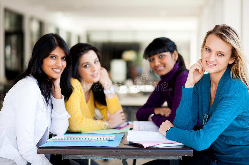 Students Sitting By Cafeteria Royalty Free Stock Photography