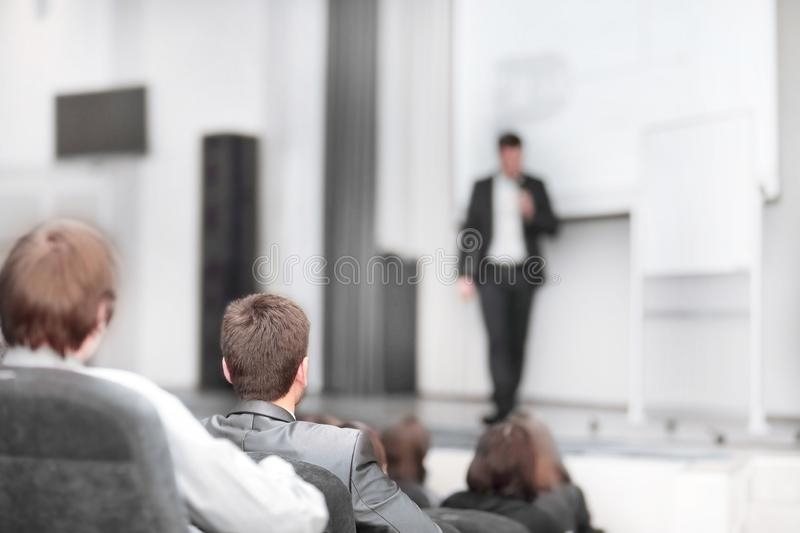 Students sitting in the hall during a business seminar royalty free stock photo