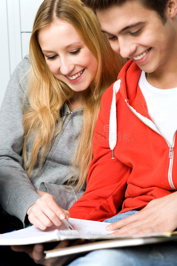 Download Students sitting together stock photo. Image of male - 21956708