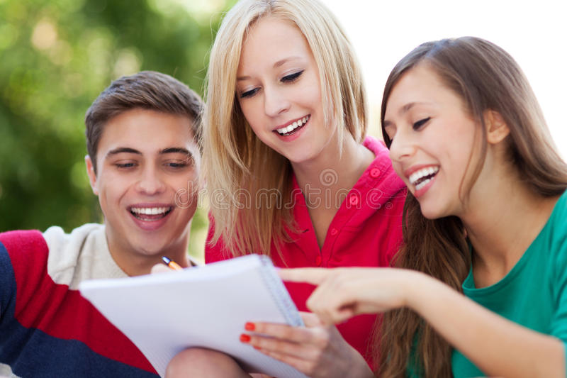 Students sitting together stock image