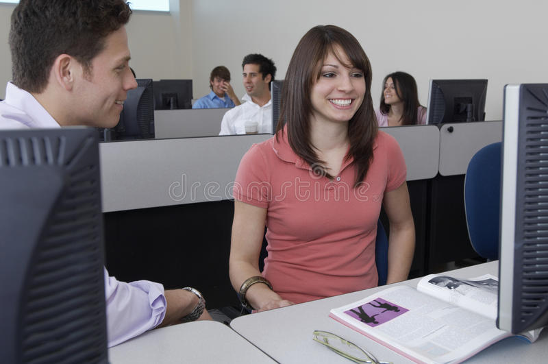 Students Sitting Together At Computer Desk Stock Photos