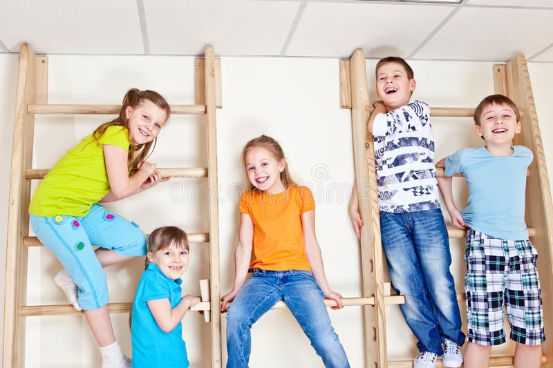Students sitting on wall bars royalty free stock photography