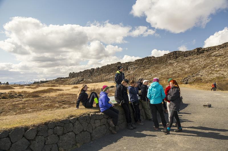 Students standing or sitting during a visit to the Thingvellir Rift Valley royalty free stock photo