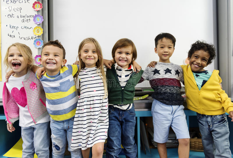Students standing together in class stock photography