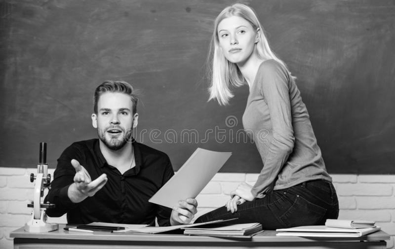 Students study before exam. ertificate proves successfully passed university entrance exam. Students in classroom. Chalkboard background. Education concept stock photography