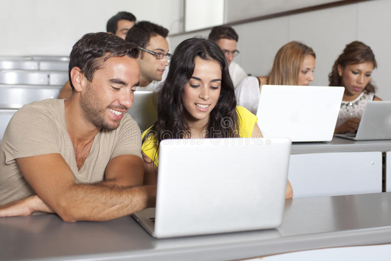 Students studying with laptop in class room royalty free stock image