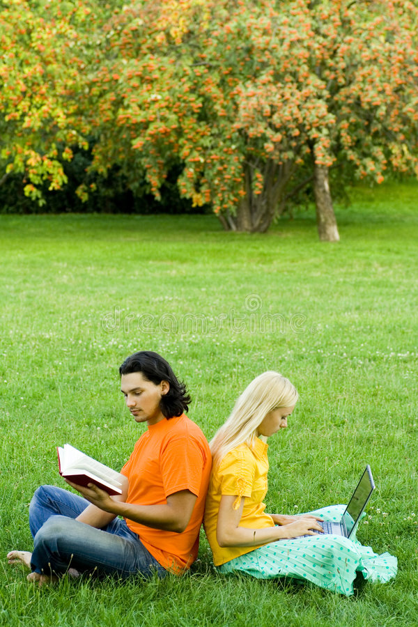 Students studying in park