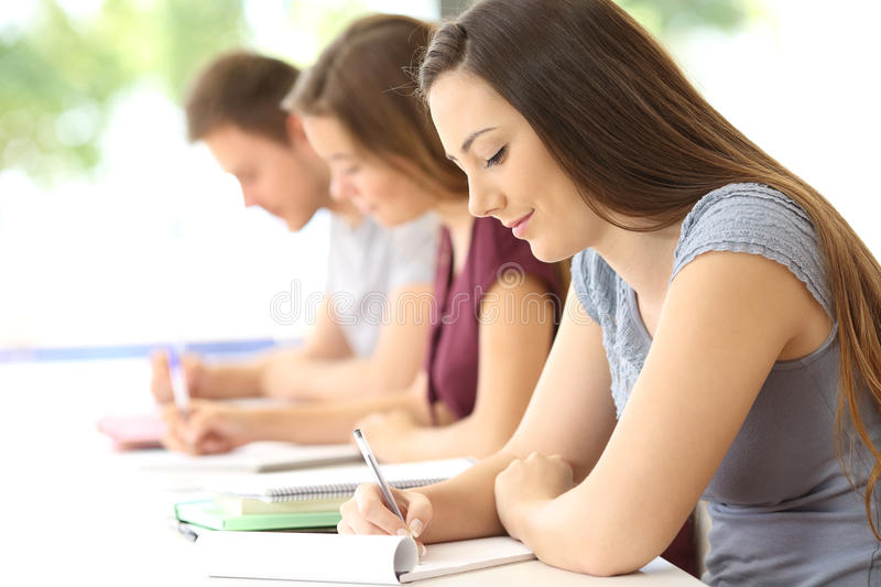 Students studying taking notes at classroom stock photography