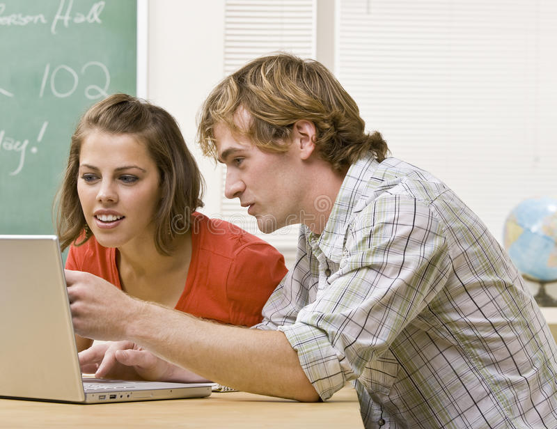 Download Students Studying Together In Classroom Royalty Free Stock Photo - Image: 17048015