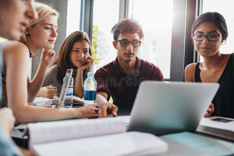 Students studying in university library royalty free stock images