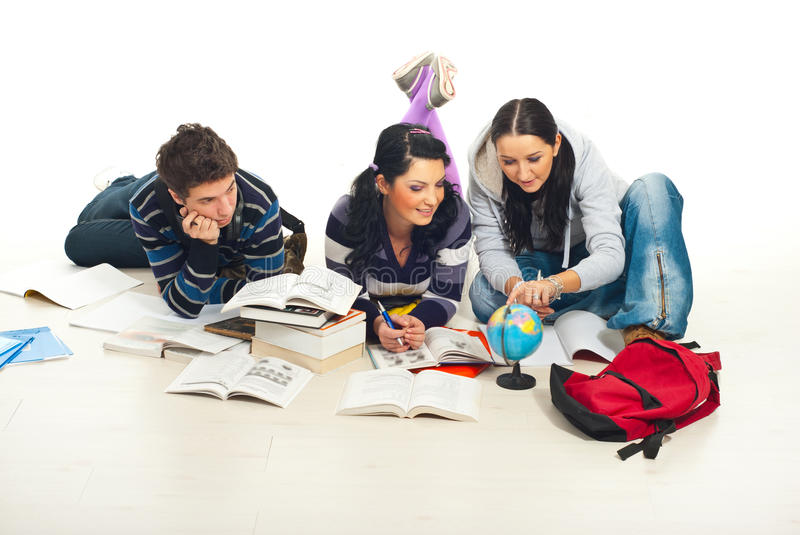 Students studying world globe home stock photography