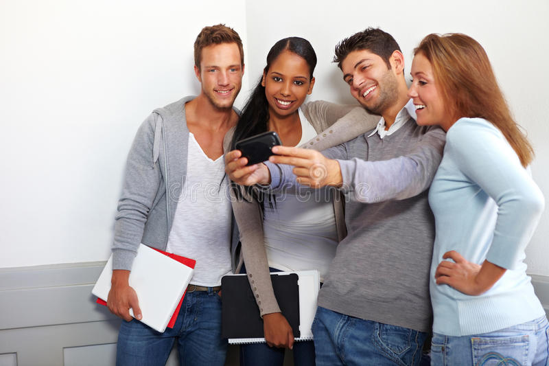 Students taking group photos stock photos